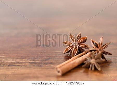 Close-up of christmas spices on a wooden table. Star anise and cinnamon with copy space.