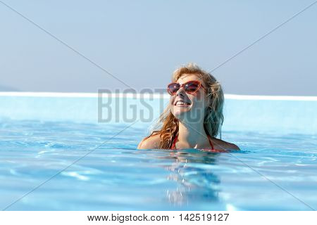 Young Attractive Woman Enjyoing Her Vacation At Resort