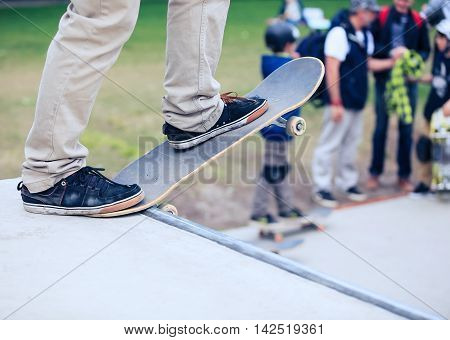 Skateboarders standing on a skate ramp in skatepark