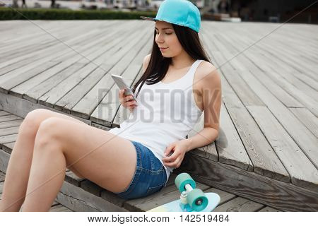 Girl Using Big Modern Phablet Smartphone With Dual Camera