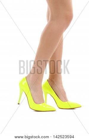 Female Legs With Yellow High Heels On A White Background