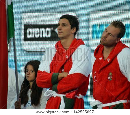 Budapest Hungary - Jul 15 2014. Daniel Varga and Viktor Nagy (sleeping) from the hungarian team waiting for the start. The Waterpolo European Championship was held in Alfred Hajos Swimming Centre in 2014.