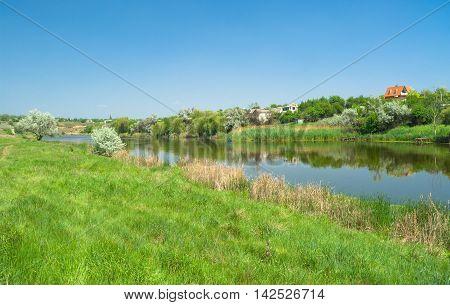 Ukrainian rural summer landscape with small river Sura