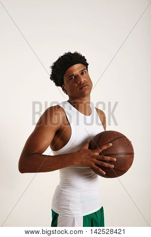 Young Black Athlete Holding A Basketball