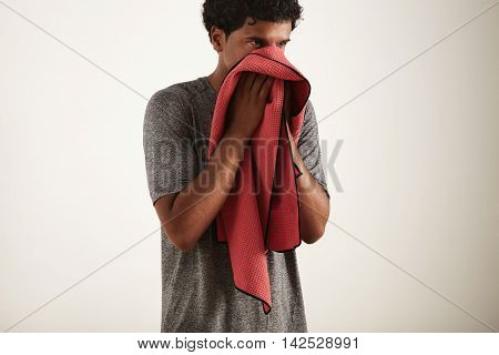 Young Black Sportsman Wiping His Face With A Towel
