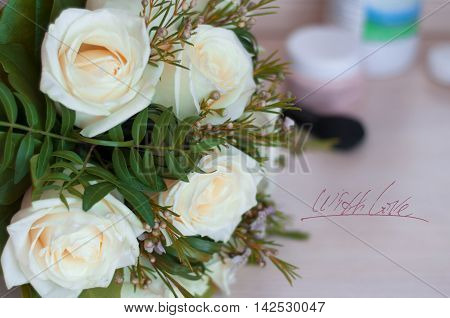 Postcard with love, celebration, bride's bouquet, wedding, flowers, white roses on the dresser