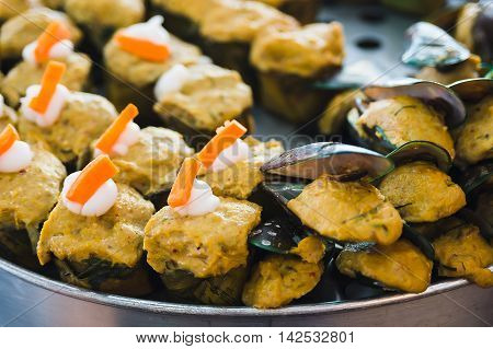 Steamed fish and clams with curry paste