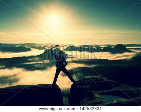 Happy Man Gesture Of Triumph With Hands In The Air. Funny Hiker On The Peak