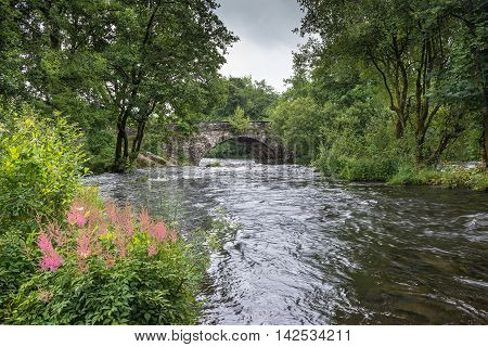 River Brathay at Skelwith Bridge. The River Brathay flows under Skelwith Bridge near Ambleside in the Lake District National Park, Cumbria, England a popular area for tourists.