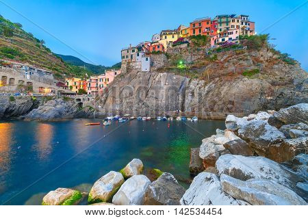 Manarola fishing village in the evening, seascape in Five lands, Cinque Terre National Park, Liguria, Italy.