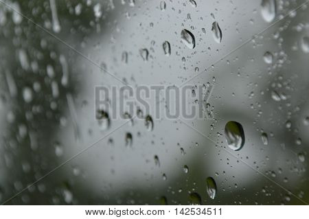 calm and gentle raindrops on a car window