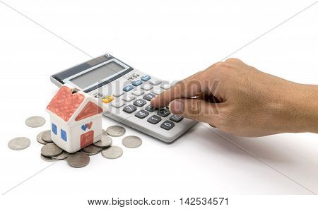 House and calculator and hand on white background