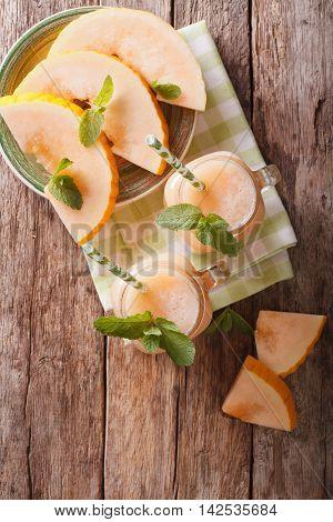 Honeydew Melon Juice Closeup On Wooden Background, Vertical Top View