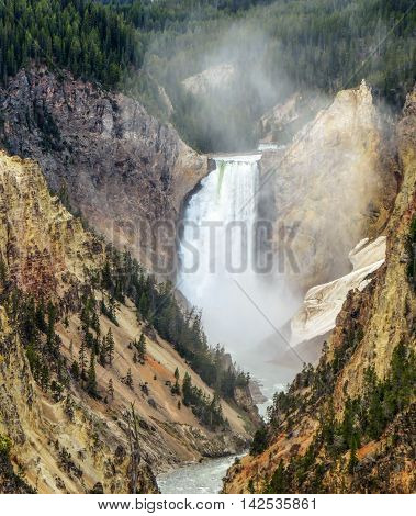Waterfall in Yellowstone National Park with valley and river