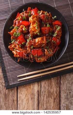 Pork In Sweet And Sour Sauce With Peppers, Carrots And Onions. Vertical Top View