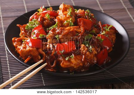 Spicy Pork With Peppers, Carrots And Onions In Sweet And Sour Sauce Close-up. Horizontal