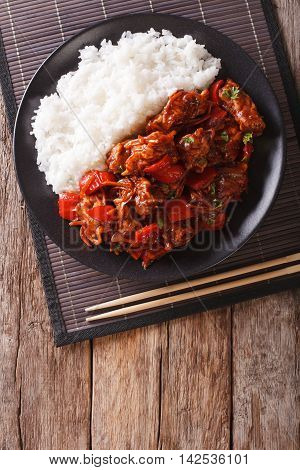 Chinese Food: Pork In Sweet And Sour Sauce With Rice Close-up. Vertical Top View