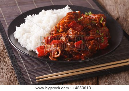 Pork Braised In Sweet And Sour Sauce With Vegetables And Rice Close-up. Horizontal