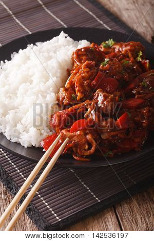 Asian Cuisine: Rice With Pork In Sweet And Sour Sauce Closeup. Vertical