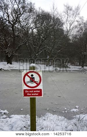 icy water warning with no swimming danger sign