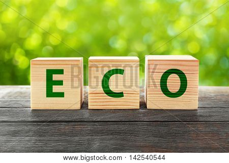 Word eco on wooden blocks. Ecological concept.