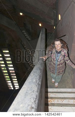 LIVERPOOL, ENGLAND, JULY 2. Liverpool Cathedral on July 2, 2016, in Liverpool, England. A high view of a woman climbing the many flights of stairs up Liverpool Cathedral's Tower England.