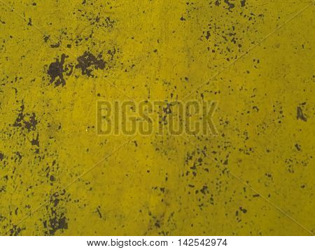 aged and decayed yellow surface made of metal