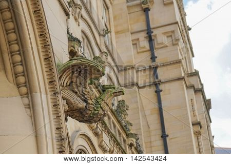 Stone gargoyle on the side of a building