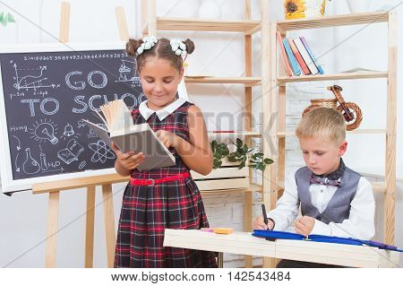 Girl and boy reading books during class.The concept of education and children's knowledge
