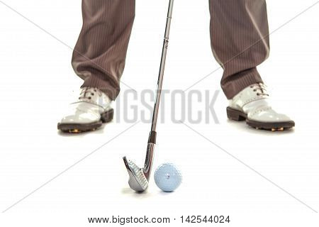 golfer in whire studio address and ball