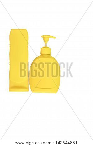Two yellow bottle on a white background