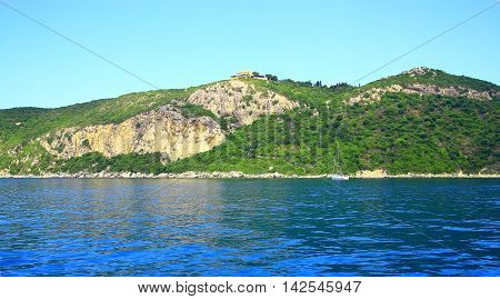 View On A Coast With A Mountain Chain And A Buildung On The Top On The Island Corfu (nearby Town Afi
