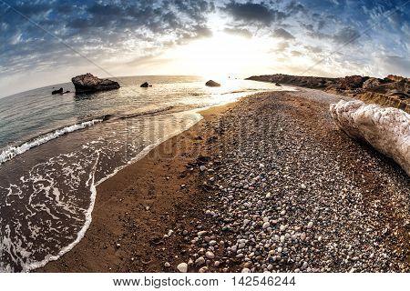Seascape near Petra tou Romiou also known as Aphrodite's Rock. Paphos District Cyprus.