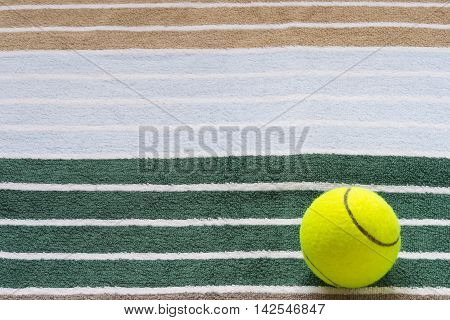Ball for tennis on a towel, background towel