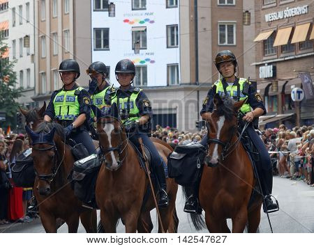 STOCKHOLM SWEDEN - JUL 30 2016: Four female polices on horses in the Pride parade July 30 2016 in Stockholm Sweden