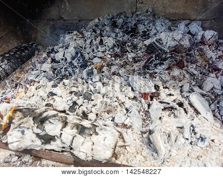 Charcoal in the oven for a barbecue on the grill.