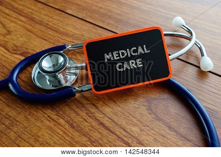 Medical Concept.word Medical Care With Stethoscope On Wooden Table.