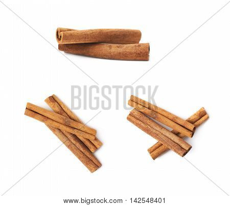 Pile of multiple cinnamon sticks isolated over the white background, set of three different foreshortenings