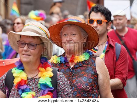 STOCKHOLM SWEDEN - JUL 30 2016: Senior women wearing a rainbow colored scarf in the Pride parade in the Pride parade July 30 2016 in Stockholm Sweden