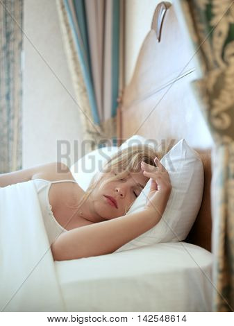 close up portrait of sleeping young woman on color back