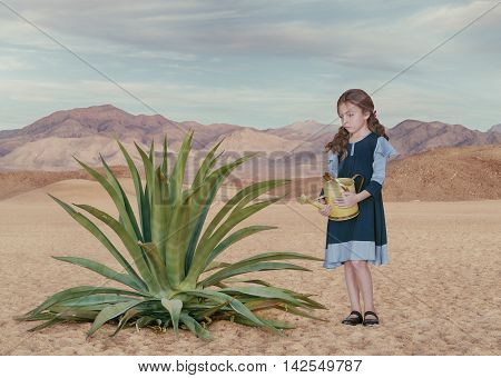 Portrait of little white girl with watering can in desert environment
