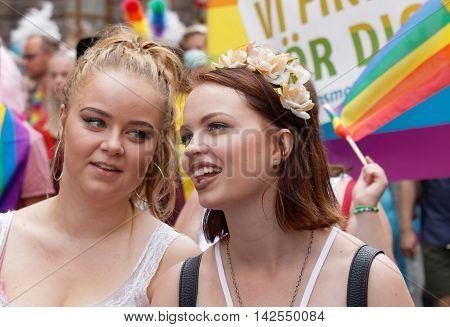 STOCKHOLM SWEDEN - JUL 30 2016: Two beautful smiling girls in the Pride parade July 30 2016 in Stockholm Sweden