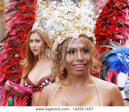 STOCKHOLM SWEDEN - JUL 30 2016: Women from south america dressed in colorful carnival clothes and a crown in the Pride parade in the Pride parade July 30 2016 in Stockholm Sweden
