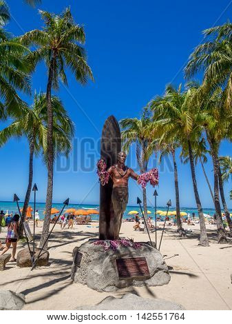 WAIKIKI, HI - AUG 3: Duke Kahanamoku Statue on Waikiki Beach on August 3, 2016 in Honolulu. Duke famously popularized surfing and won gold medals for the USA in swimming.
