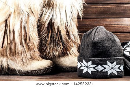 Stylish women's winter boots with fur scarf and hat