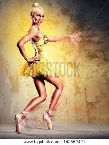 Beautiful ballerina in yellow tutu on point. Image with a digital effects