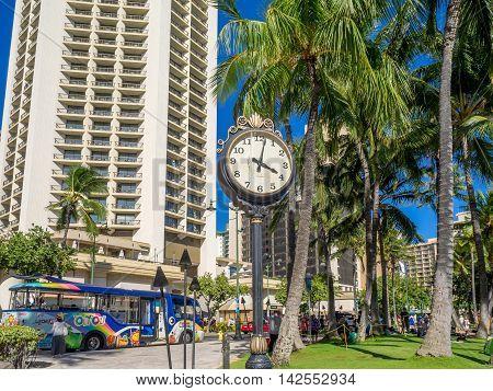 HONOLULU, HI - AUG 4: An old victorian era clock at Waikiki Beach on August 4, 2016 in Honolulu, Hawaii. Waikiki Beach is a popular destination for sun loving tourists.