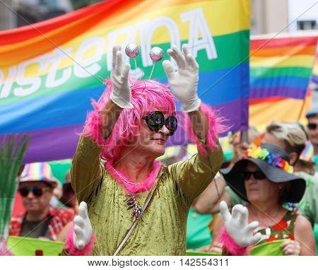STOCKHOLM SWEDEN - JUL 30 2016: Senior transvestite man with a pink wig in the Pride parade July 30 2016 in Stockholm Sweden