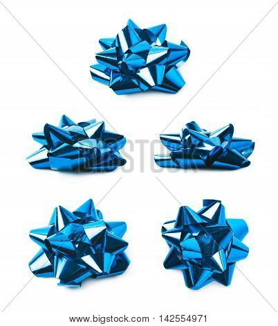 Decorational bow made of glossy blue tape, composition isolated over the white background, set of five different foreshortenings