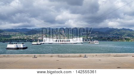 OAHU, HI - AUG 5, 2016: The USS Arizona Memorial on August 5, 2016 in Pearl Harbor, USA. Memorial marks resting place of sailors and Marines who died when the USS Arizona was sunk by Japan.